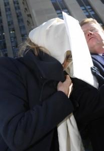 Yanna Avis, 64, hides in shame.